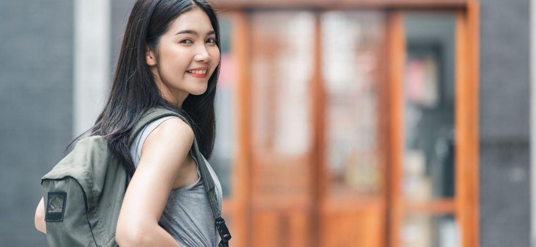 Traveler Asian woman traveling and walking in Beijing, China, ba