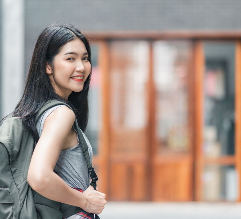 Traveler Asian woman traveling and walking in Beijing, China, backpacker female feeling happy spending relax time in holiday trip. Lifestyle women travel in Asia city concept.